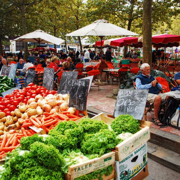 Cafés and weekly farmers market on Place Carnot Carcassonne